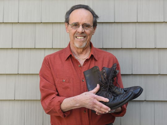 Paul Caminiti of Mahwah holds the pair of Army boots he was wearing when he and his fellow recruits pulled survivors and bodies from the wreckage of a Douglas Liftmaster transport plane that crashed shortly after taking off from Fort Dix on July 13, 1956.