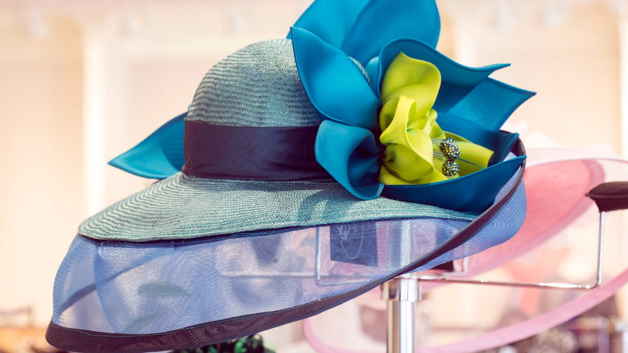 Christine Moore, milliner at Rodes for Her, holds nothing back when she talks about hats and offers tips.
