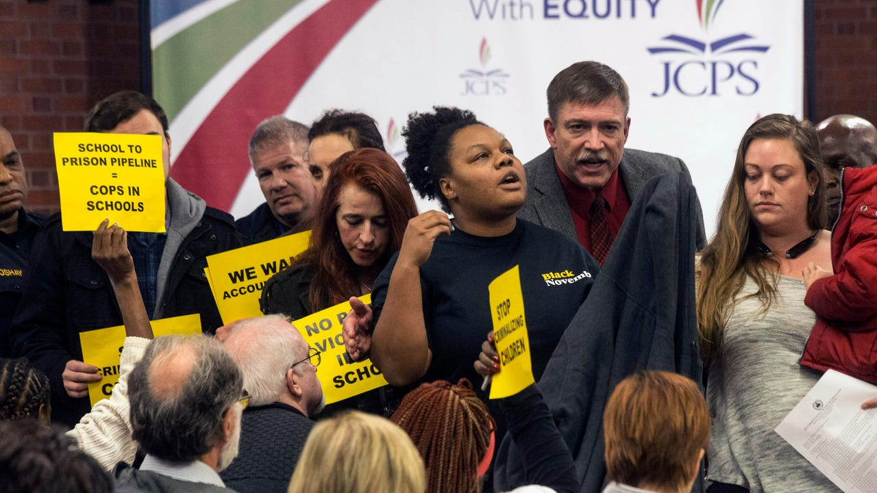 Chanelle Helm of Black Lives Matter Louisville expresses her group's concerns over the safety of African American children in Jefferson County public schools after being removed from a JCPS board meeting.
