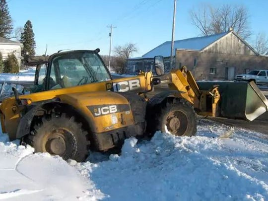 A Loadall telescopic handler sits in the ditch after