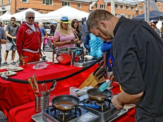 Toast Chef Chris Gadulka prepares his sauces at the