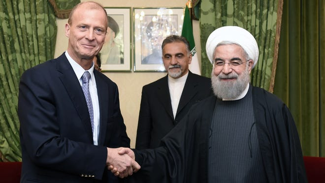 CEO of European aerospace giant Airbus Group Thomas Enders, left, greets Iranian President Hassan Rouhani on Jan. 28, 2016, during a meeting in Paris.