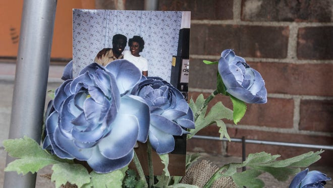 A photo of Darnell Thomas Wicker and his girlfriend of 22 years Anita Louise Jones has now become part of a memorial site at the Broadleaf Arms Apartment where Wicker was shot and killed by LMPD early Monday morning. 8/9/16