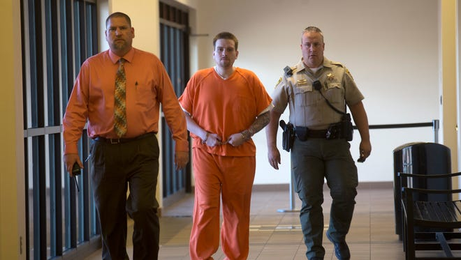 Timothy Serrano is escorted in to court for a sentencing hearing on Oct. 31 at Aztec District Court.