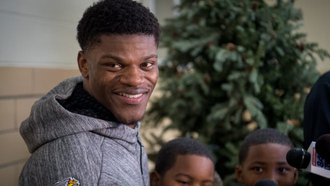University of Louisville quarterback Lamar Jackson speaks with the media about his Heisman Trophy nomination during a press conference at West End School in Louisville, Kentucky, Friday, December 6, 2017