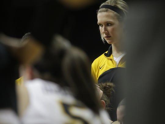 Iowa's Hailey Schneden listens to head coach Lisa Bluder