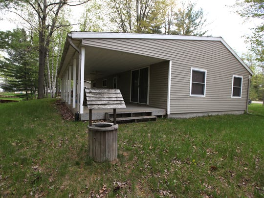 This cottage home is on canal to Secord Lake. It has 1,080 square feet, three, bedrooms, two baths and a pole barn, It's listed for $69,000 and offered by Lady of the Lake North Realty.