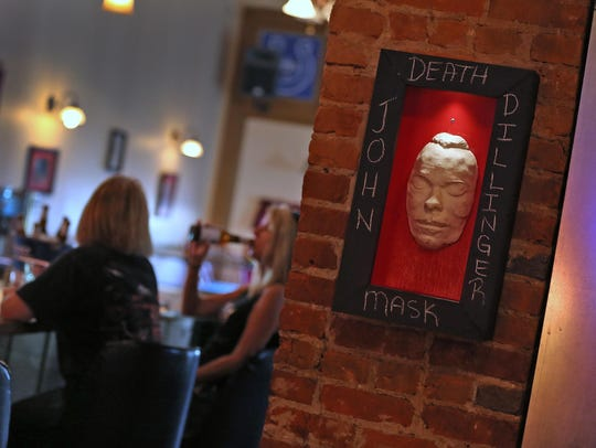 """A """"death mask"""" of John Dillinger is seen on the wall"""