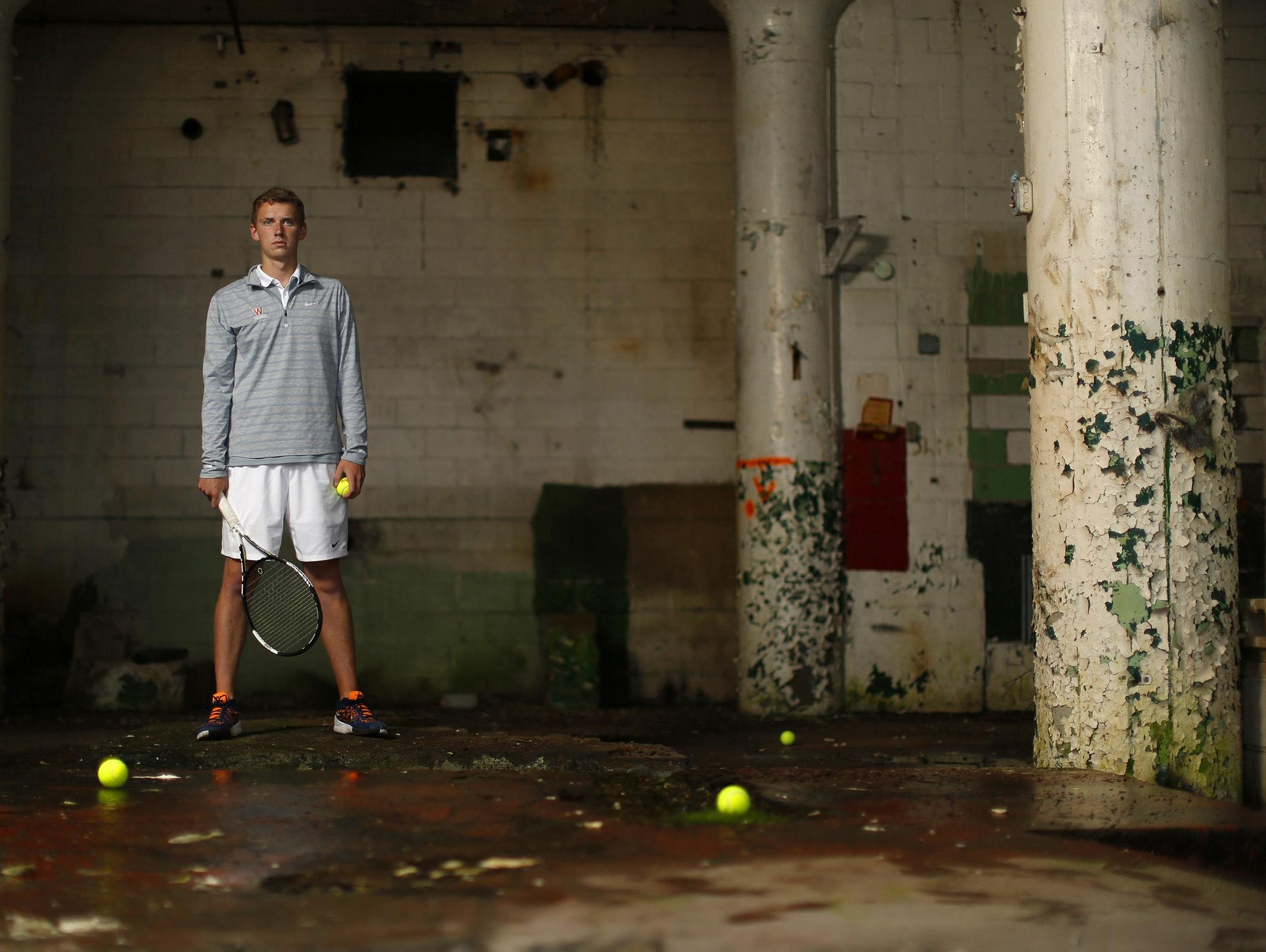 West De Pere's Jack Dykema, shown inside the former Larsen Canning Co. in the Broadway District in downtown Green Bay, is the Press-Gazette Media boys tennis player of the year.