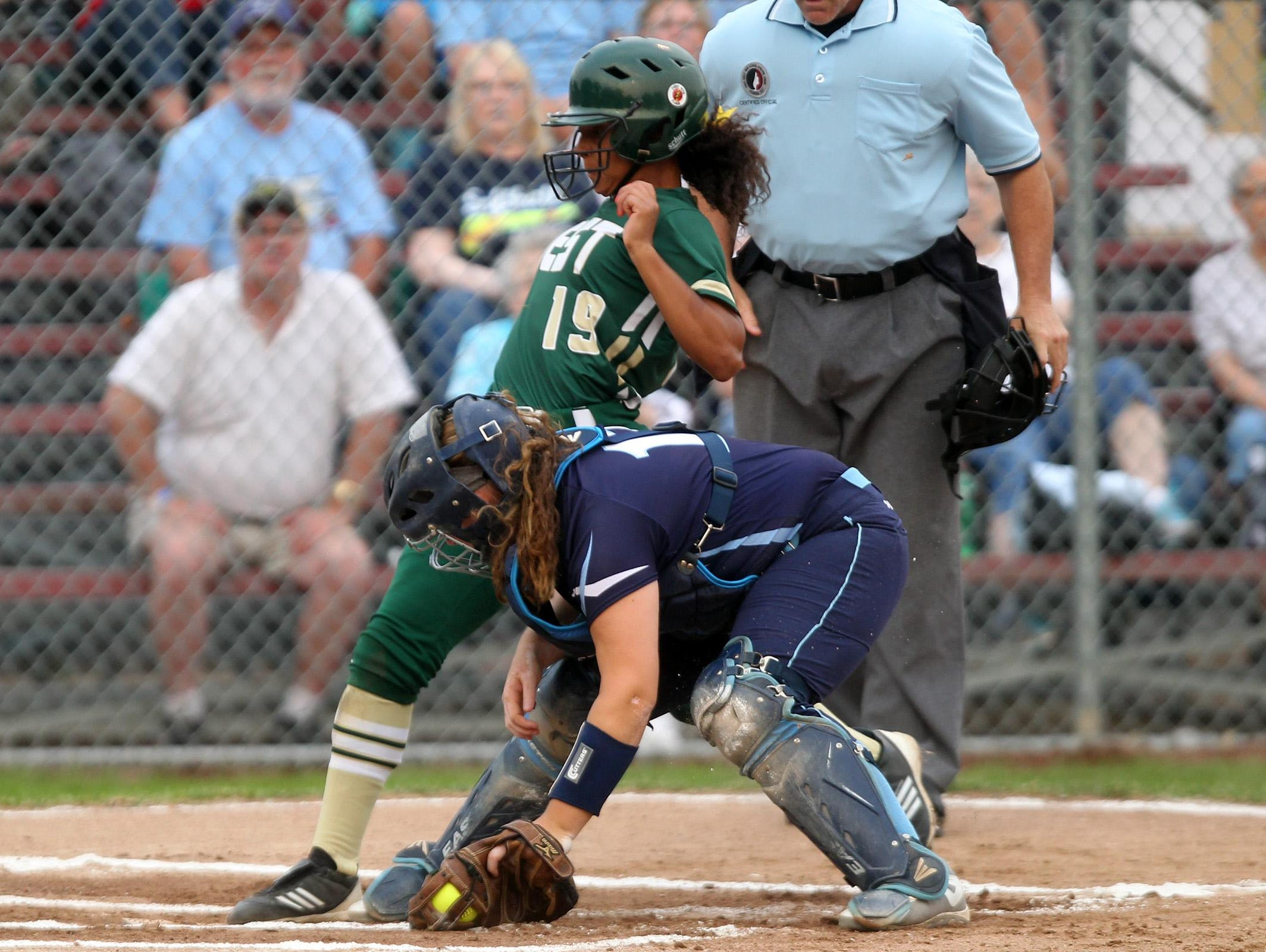 West High's Taleah Smith gets tagged out at home plate during the Women of Troy's second game against Cedar Rapids Jefferson in Cedar Rapids on Tuesday, June 30, 2015.