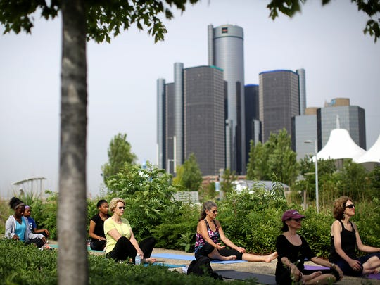 Michelle Moten, of Urban Solace studio, leads the Yoga on the Riverfront class in the wetland area of Milliken State Park in Detroit on Friday, June 26, 2015.The classes are free and sponsored by Blue Cross Blue Shield and the Detroit Riverfront Conservancy.