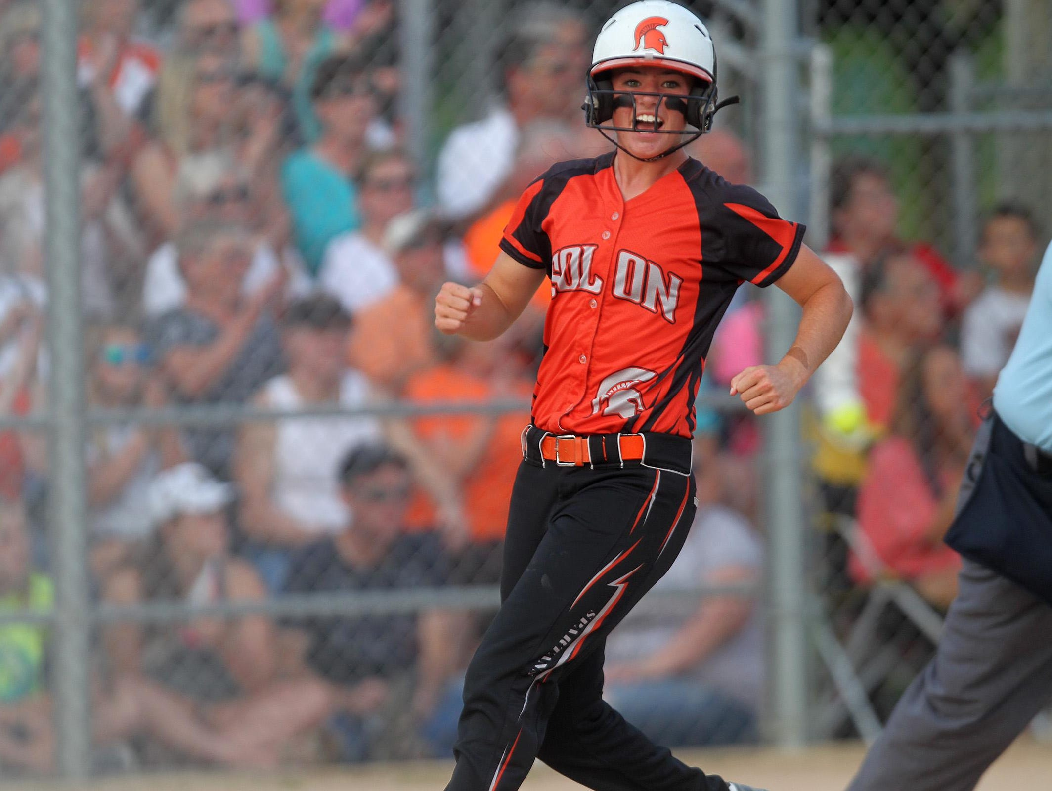 Solon's Sydney Lawson celebrates as she runs to home plate during the Spartans' regional game against Mid-Prairie at Solon on Friday, July 10, 2015.