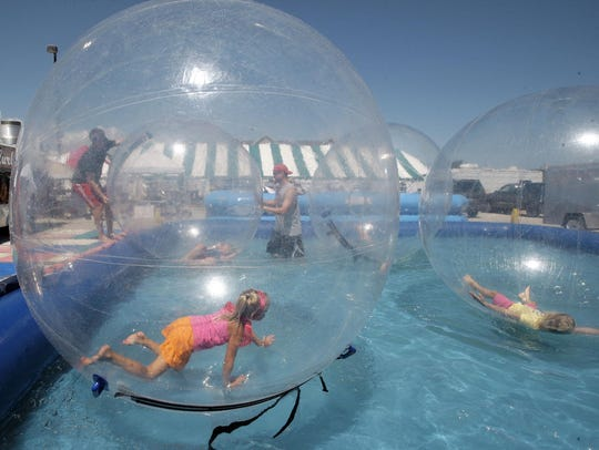 Kids frolic in an Aquaball during a past Miesfeld's