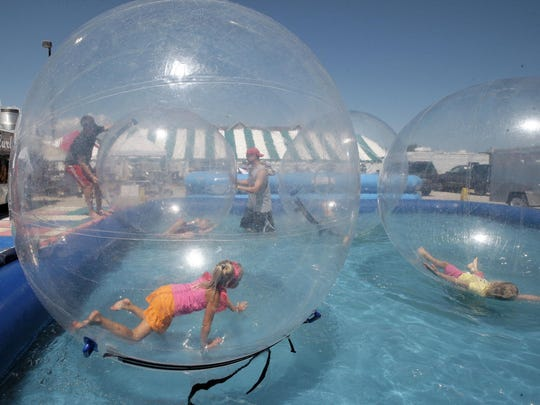Kids frolic in an Aquaball during a past Miesfeld's Lakeshore Weekend at South Pier.