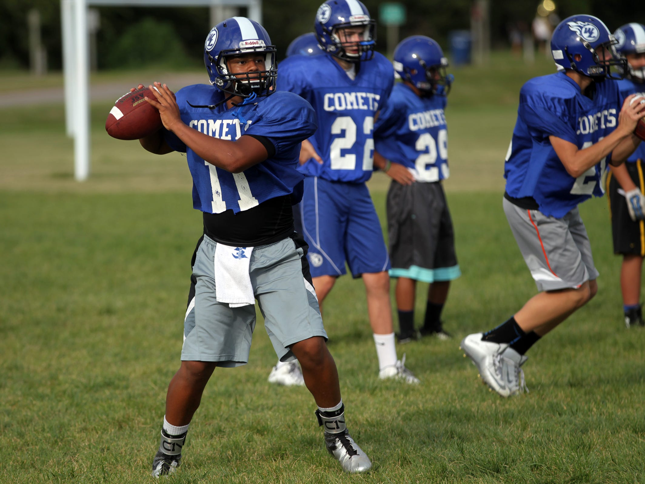 West Liberty senior quarterback Josh Walshire throws a pass during practice on Thursday, Aug. 13, 2015. David Scrivner / Iowa City Press-Citizen