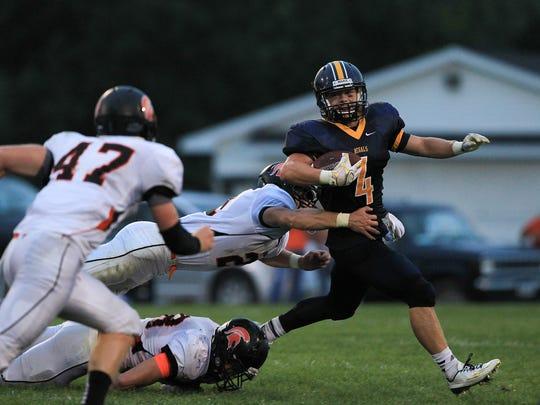 Regina's Nick Phillips breaks a tackle against Solon