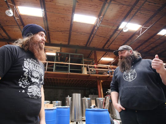 Jason Petrocik, 27, left and Ian Radogost, 33,  are co-owners of Cellarmen's, the first Hazel Park meadery, cidery, brewery opening at 24310 John R in a former lumber store that is set to open Saturday, Oct. 17, 2015 from noon to midnight. They are standing in the back room where production happens. Photographed Monday, Oct. 12, 2015.