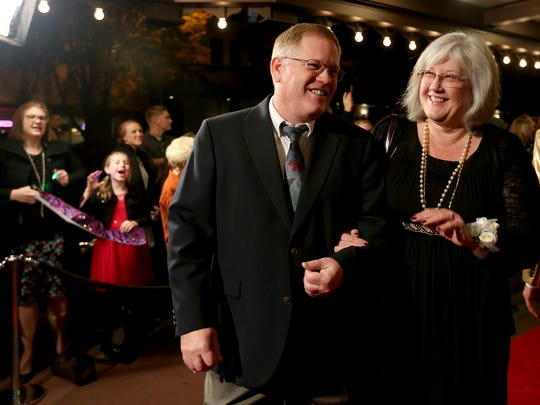 Theresa Gilman, with Stephens Middle School, walks the red carpet with her husband at the Salem-Keizer Education Foundation's 19th annual Crystal Apple Awards ceremony at the Elsinore Theatre in Salem on Thursday, Nov. 5, 2015.