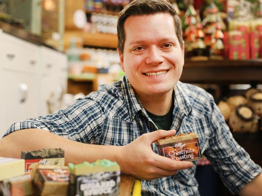 Brandon Mitchell, 37, of Plymouth Township makes handmade small batch vegan and cruelty-free soap in dozens of scents. He has turned this into his full-time gig. His product sells in a variety of boutique stores in Michigan, Kentucky, Pennsylvania and online. Along with being stocked in stores he sells his soaps in the Detroit Metro area at various craft fairs focused on local handmade goods. He is photographed at one of the boutiques his soap is stocked in called Poesy at 32184 Woodward Ave. in Royal Oak Tuesday, Nov. 10, 2015.