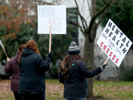 People protest a contract negotiated on their behalf by SEIU that they say will cut providers' reimbursement for caring for mental health clients by up to 60 percent at the Oregon State Capitol in Salem on Tuesday, Dec. 1, 2015.