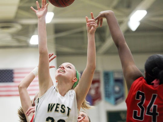 West High's Maddie Huinker takes a shot during the Women of Troy's game against City High at West High on Friday, Jan. 8, 2016.