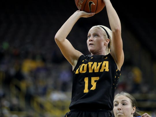 Iowa's Whitney Jennings takes a shot during the Hawkeyes'