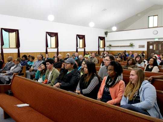 A diverse and attentive audience gathered in the sanctuary for a panel discussion and service at Salem Mission Faith Ministries following a march in celebration of Martin Luther King Jr. Day in Salem on Monday, Jan. 18, 2016.