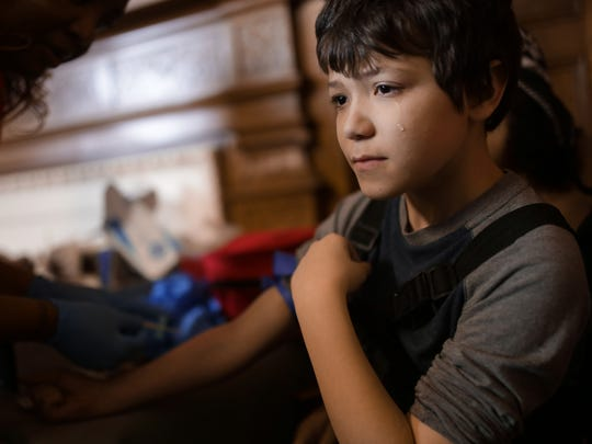 Mycal Anderson, 9, of Flint sheds a tear while having a blood sample taken to be tested for lead on Saturday, Jan. 23, 2016, at the Masonic Temple in downtown Flint.