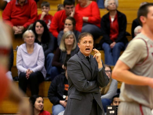 Western Oregon head coach Jim Shaw calls out to his team in the Western Washington University vs. Western Oregon University men's basketball game at Western Oregon University in Monmouth on Thursday, Feb. 11, 2016. Western Oregon won the game 90-85.