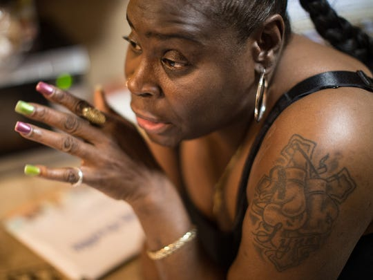 Flint resident Sherry Savage talks about how she has developed a rash in different areas of her body she says are due to using the Flint water on Friday February 5, 2016 at her home on Flint's south side.