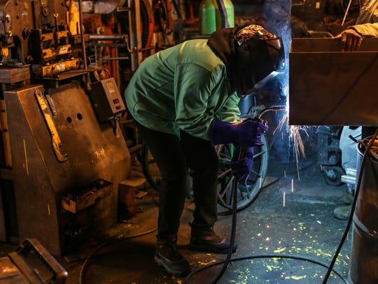 Jazmond Ravarra of Detroit practices welding during