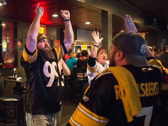 Steelers fan Steven Yankay, left, cheers along with Leeane Sherwood and Jay Yateman, right, during the AFC Wildcard playoff game between the Baltimore Ravens and Pittsburgh Steelers at The Cove on Saturday, Jan. 3, 2015.