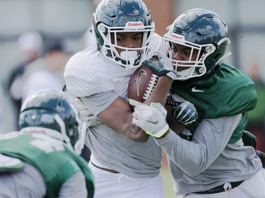 "True freshman receiver Donnie Corley powers through a drill with safety Montae Nicholson during an MSU practice Tuesday, April 12, 2016 in East Lansing. Coach Mark Dantonio called Corley ""an exceptional athlete"" and ""a quick learner."""