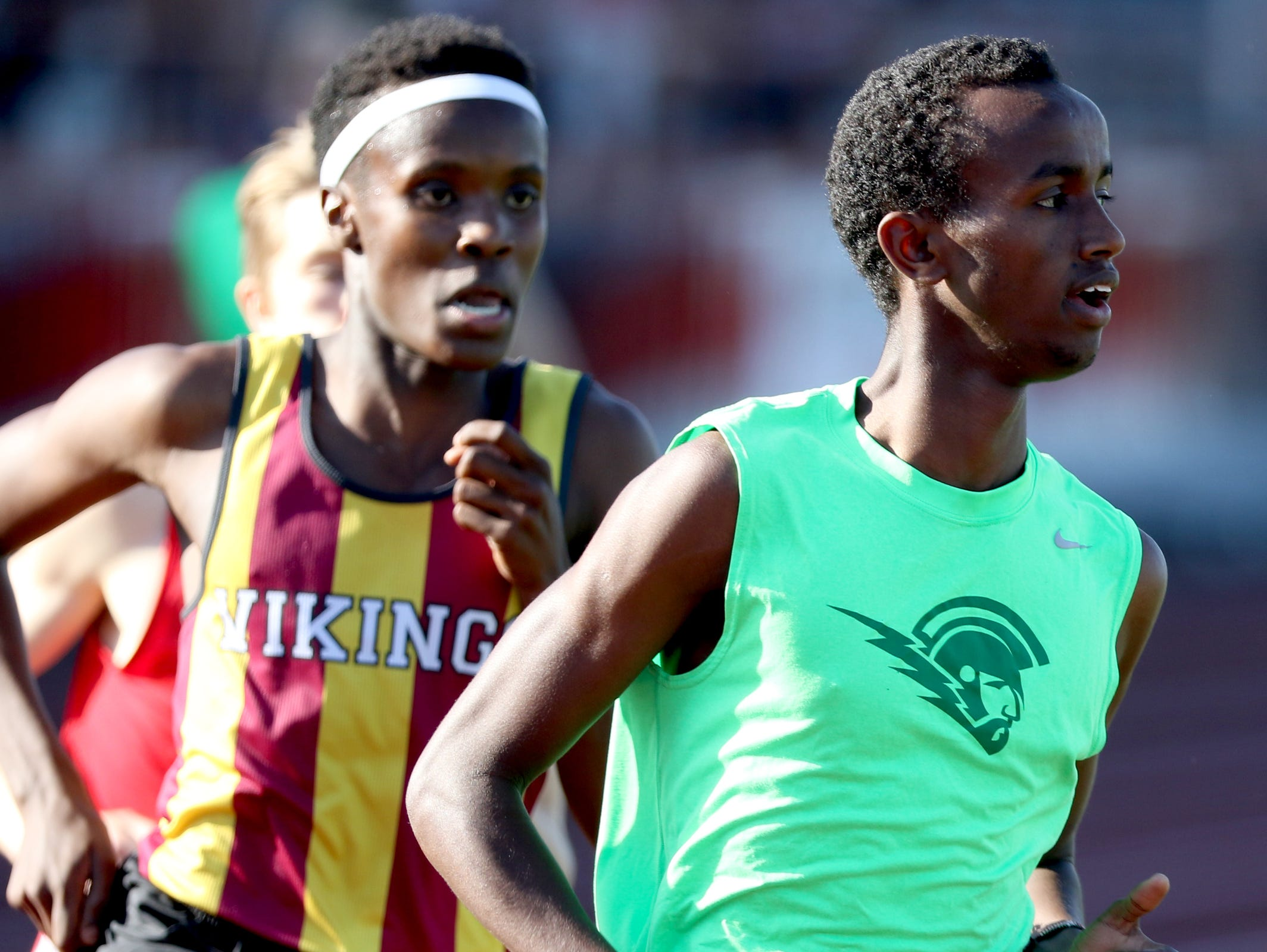 West Salem's Ahmed Muhumed, right, competes in the finals of the boys 1500 meters at the Greater Valley Conference District Championships track and field meet at McMinnville High School on Friday, May 13, 2016. Muhumed placed first.