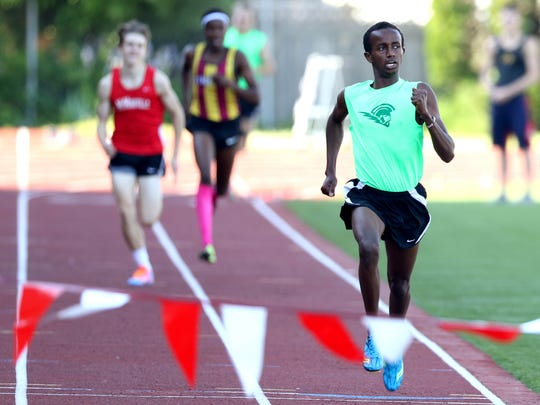 West Salem's Ahmed Muhumed, right,finishes first in the finals of the boys 1500 meters at the Greater Valley Conference District Championships track and field meet at McMinnville High School on Friday, May 13, 2016.