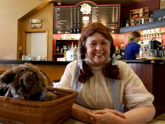 Karyl Carlson brought Toto and lots of information about Oz Con to Appeal Tribune's new community column, Creekside Cafe, on Wednesday, May 18, 2016 at Silver Falls Coffee House in Silverton.