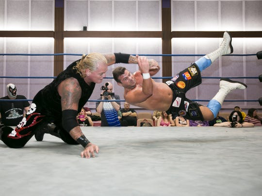 Matt Striker (right) faces Gangrel (left) at a past West Coast Wrestling Connection event.