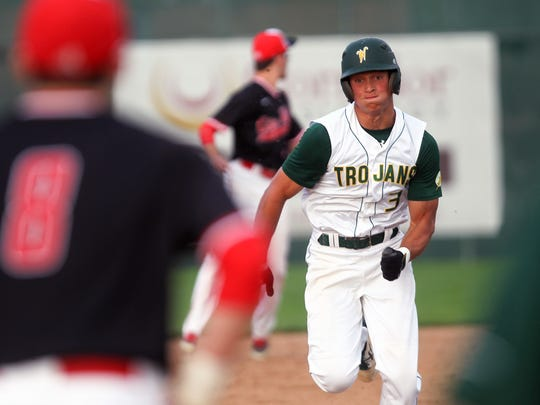 West High's Oliver Martin sprints to third base during the Trojans' game against City High at West High on Tuesday, July 7, 2015.   David Scrivner / Iowa City Press-Citizen