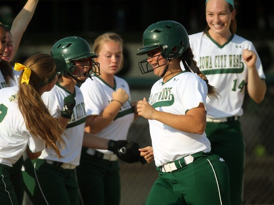 West High's Taylor Libby gets greeted at home plate after her home run during the Women of Troy's game against Linn-Mar on Thursday, July 9, 2015.   David Scrivner / Iowa City Press-Citizen