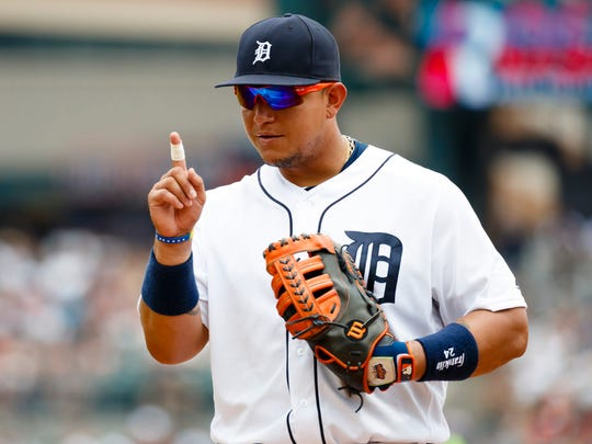 Tigers first baseman Miguel Cabrera signals to the Cleveland Indians dugout in the fourth inning at Comerica Park.