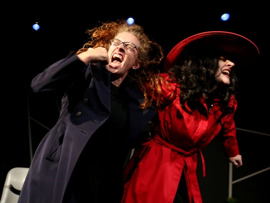 """Christa Karschnia, as Jean, left, and Kate Thompson, as The Stranger, duke it out in a scene from The Verona Studio's 2015 production of """"Dead Man's Cell Phone."""""""
