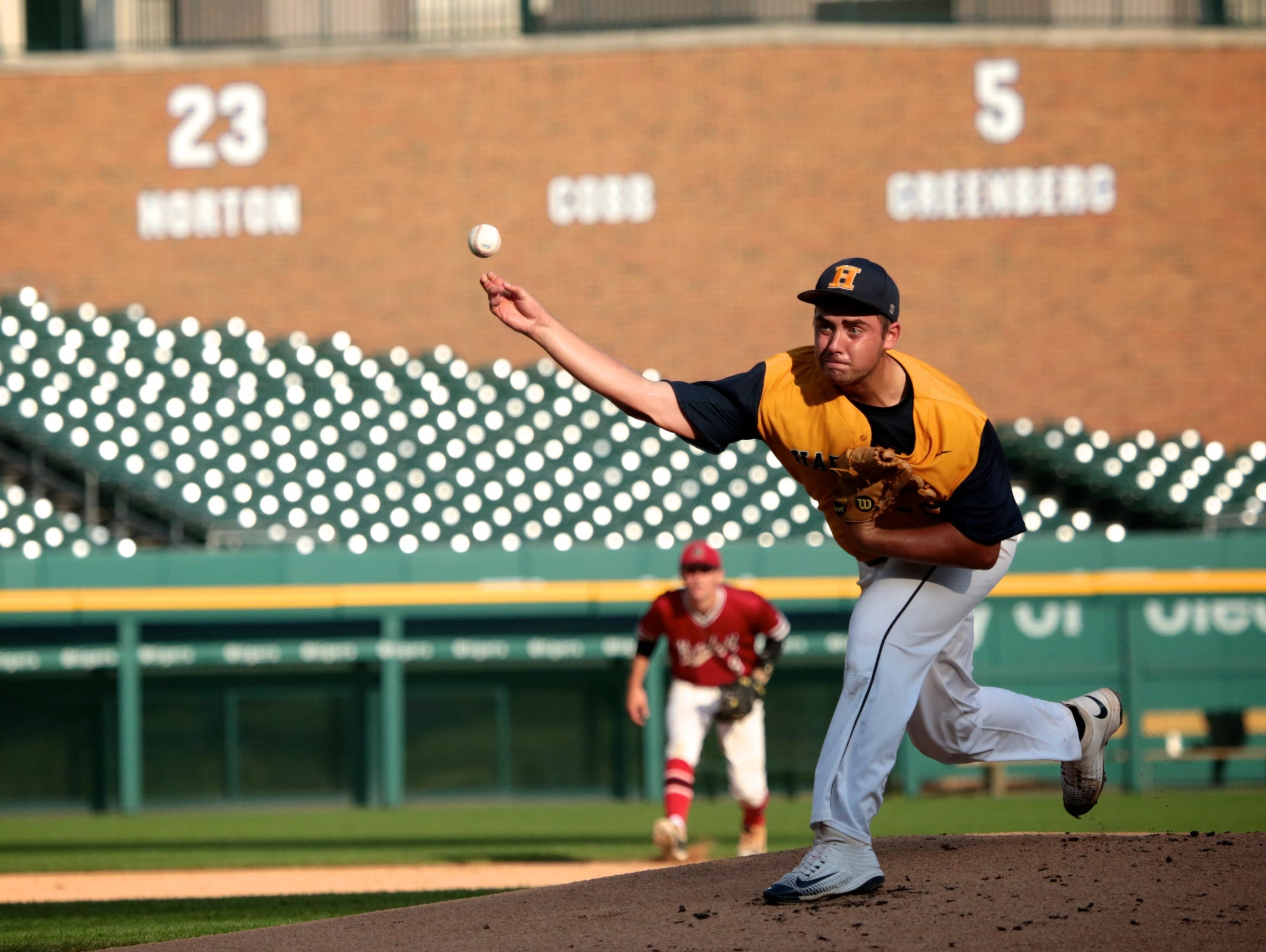 Hartland John Baker (25) throws the ball during the Michigan High School Baseball Coaches Association All-Star game on Wednesday at Comerica Park.