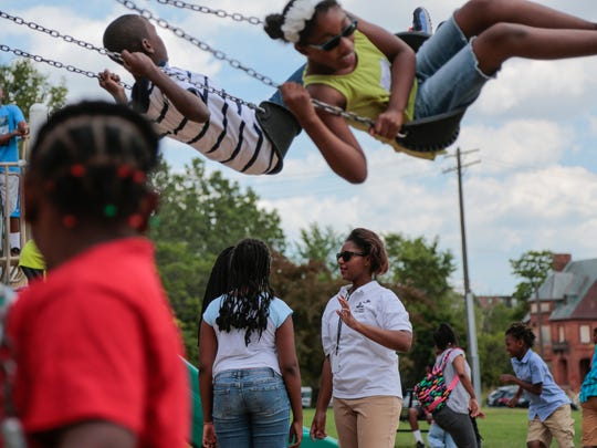 Monique Whittaker (center), 17, of Detroit, keeps an eye on students during recess at Peck Park in Detroit involved in Camp Africa at the Charles H. Wright Museum of African American History in Detroit on Monday July 18, 2016 while working as a camp counselor through Grow Detroit's Young Talent program.