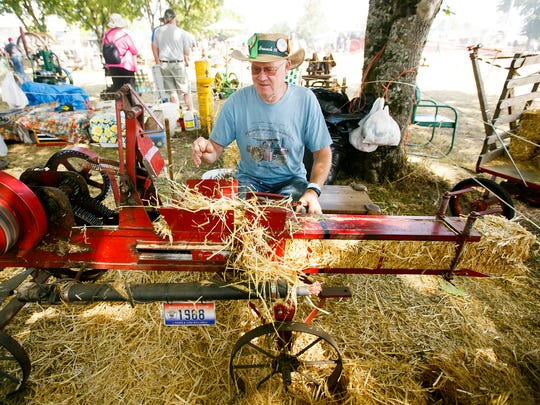 Norman Willard makes small bales of hay on his miniature hay baler at the 46th annual Great Oregon Steam-Up on July 31, 2016, at Antique Powerland.