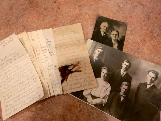 Photographs of Marlene Rhodes' great-grandparents and grandfather with his siblings, along with letters written by her great-grandfather to to her great-aunt. The letters were written in the 1930s. The letters were able to find their way back to the family after a story in the Statesman Journal. Photographed in Salem on Friday, July 29, 2016.