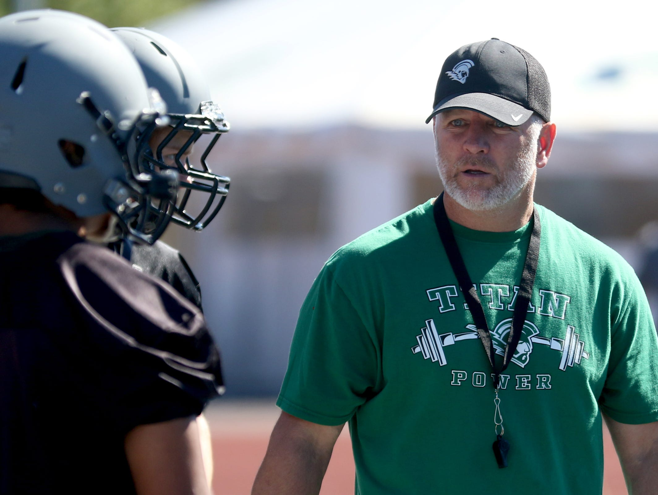 Head Coach Shawn Stanley talks to his players during football practice at West Salem High School on Monday, Aug. 15, 2016.