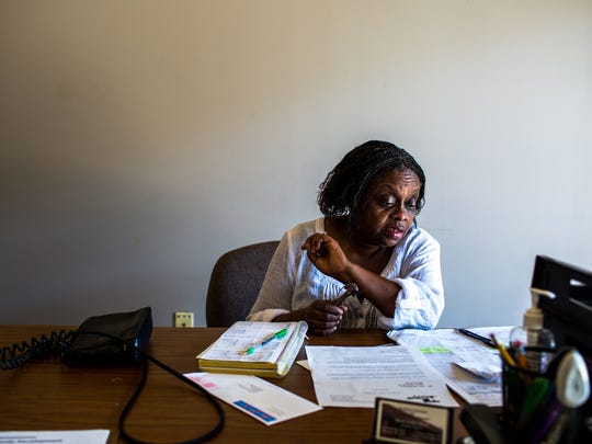Mattie Jordan-Woods, 60, executive director of Northside Association for Community Development, looks over her calendar at her office on North Park Street in Kalamazoo, Mich. on Friday, Aug. 26, 2016.