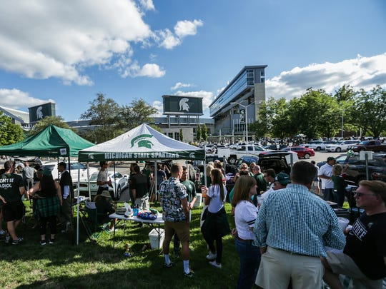 Michigan State fans tailgate before home game opener