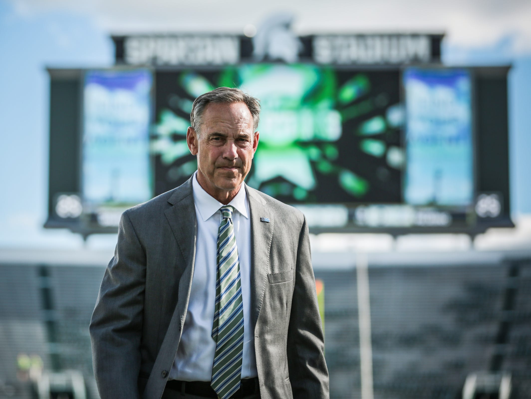 Michigan State Spartans head coach Mark Dantonio walks on the field before his team's opener against the Furman Paladins at Spartan Stadium in East Lansing, Michigan, on Friday, September 2, 2016.