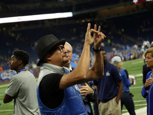 Musician Kid Rock salutes the fans before the Detroit